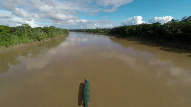 aerial ascends from boat moving along amazon river - manaus stock videos and b-roll footage