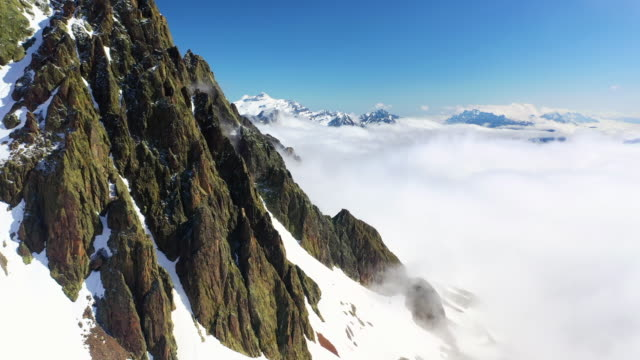 aerial ascent: awesome sunlit snowy mountain peak - mount blanc, france - mont blanc stock videos & royalty-free footage