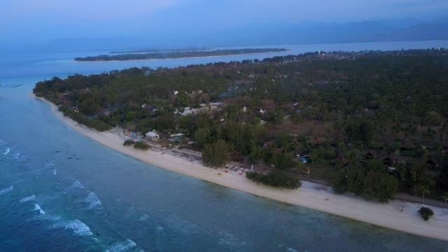 aerial ascent: small islands in the ocean at dusk - town stock videos & royalty-free footage