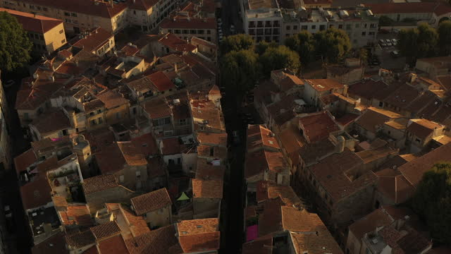 aerial at arles, france at sunrise with the camera tilted over the arles amphitheater and moving forward. - amphitheatre stock videos & royalty-free footage