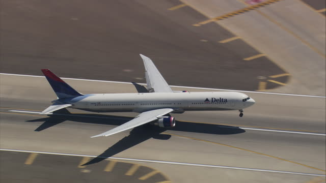 aerial at los angeles international airport, air to air of delta airlines jet airliner taking off / california, united states - delta stock videos and b-roll footage