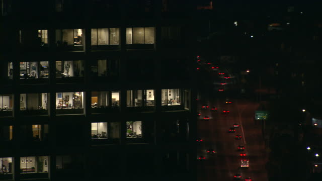 stockvideo's en b-roll-footage met aerial cu at night of lights in skyscraper windows of apartment / beverly hills, california, united states. - beverly hills californië
