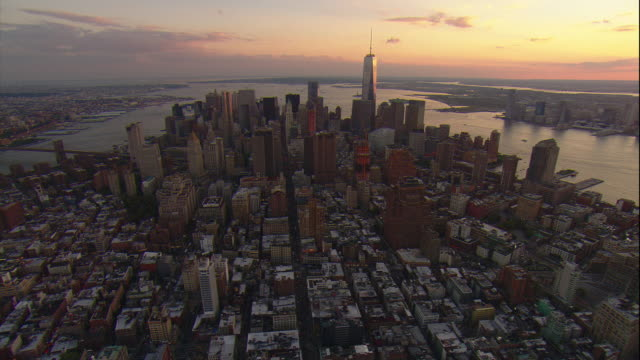 Aerial -At sunset, looking south over lower Manhattan toward the Freedom Tower.