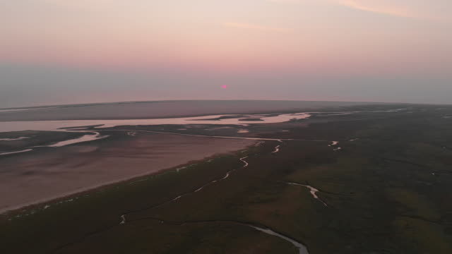 aerial at sunset of the extensive salt marshes and tidal flats near böhler strand, st peter-ording, north friesland - mud flat stock videos & royalty-free footage