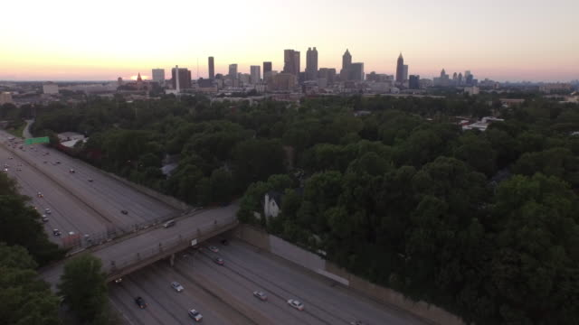 4k aerial atlanta sunset - drone aerial video city views in 4k beautiful reveal with traffic and homes in view - aircraft point of view stock videos & royalty-free footage