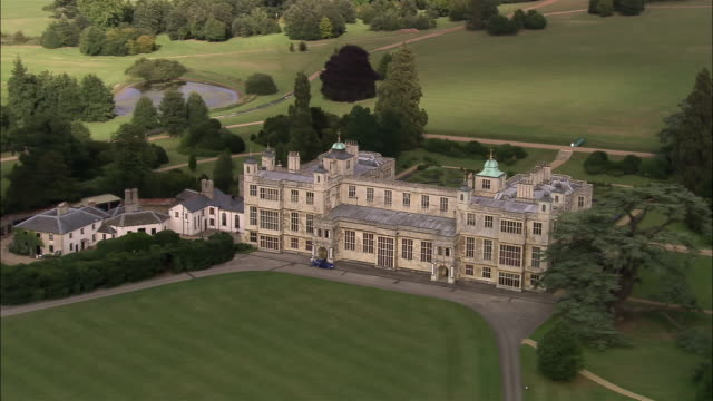 stockvideo's en b-roll-footage met aerial audley end house in english countryside / essex, england - landhuis