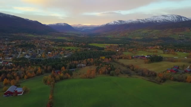 aerial: autumn in picturesque town among snowy mountains in oppdal, norway - small town stock videos & royalty-free footage