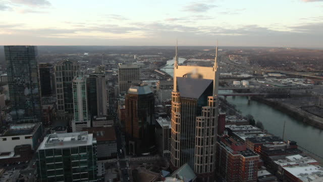 aerial back: nashville financial district nearing dusk with lovely urban architecture and river - nashville stock videos & royalty-free footage