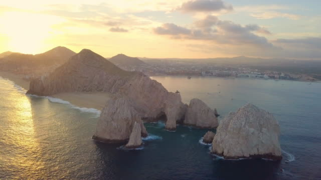 aerial backward: beautiful rock cliffs in mexico - cabo san lucas stock videos & royalty-free footage