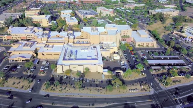 aerial backward: hospital in scottsdale arizona - eyesight stock videos & royalty-free footage