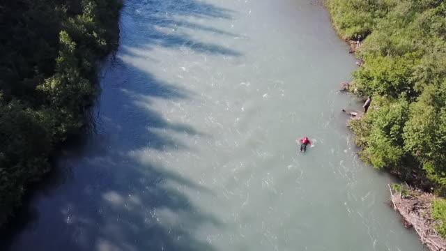 Aerial Backward: Man Enjoying the River in Alaska