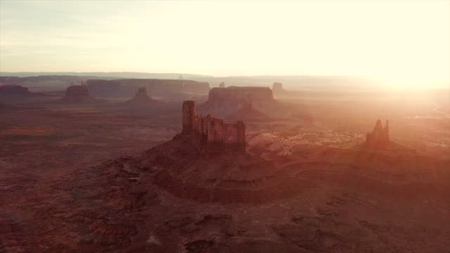 aerial backward slow: magnificent vast valley of monument valley - canyon stock videos and b-roll footage
