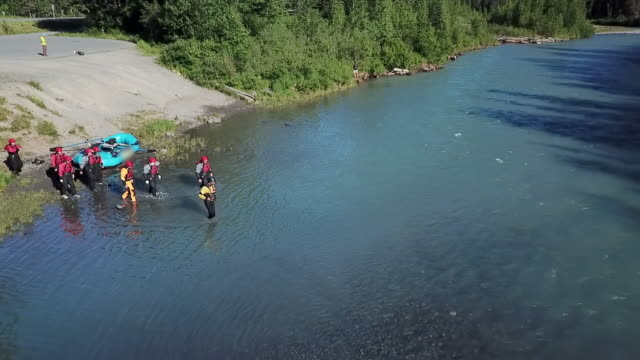 aerial backward: tourists walking in the river - chugach national forest stock videos & royalty-free footage