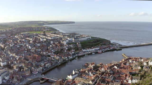 aerial backward: town and view of beautiful horizon of the waters - whitby, england - small stock videos & royalty-free footage