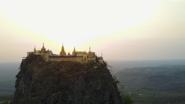Aerial Backward Wide: Monastery on Top of Taung Kalat Myanmar