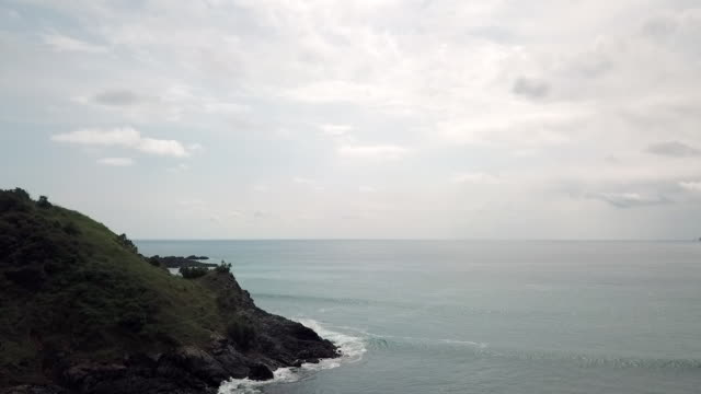 aerial: bali sea on a cloudy day in lombok, bali - bali stock videos & royalty-free footage