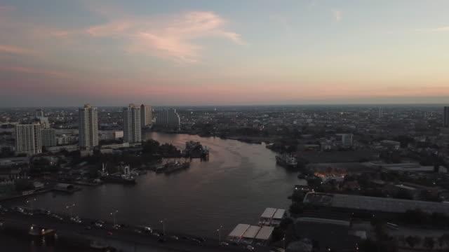 aerial bangkok riverside downtown at sunset - city street stock videos & royalty-free footage