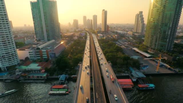 stockvideo's en b-roll-footage met aerial bangkok riverside downtown at sunset - stadsweg