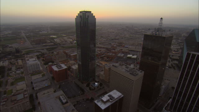 Aerial WS Bank Of America Plaza and downtown buildings / Dallas, Texas, USA
