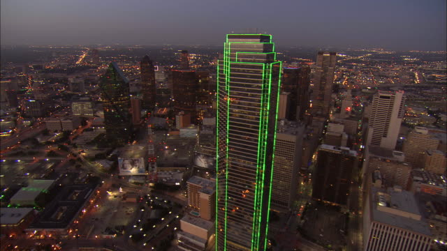 Aerial WS Bank Of America Plaza illuminated / Dallas, Texas, USA