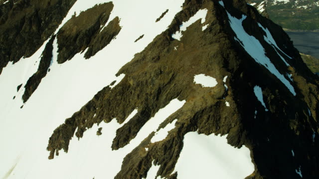 vídeos y material grabado en eventos de stock de aerial barren landscape and snow capped mountains alaska - eco tourism