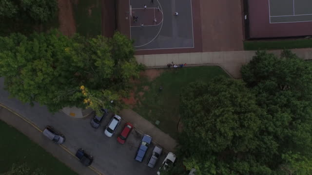 4k aerial basketball fly up 4k sports - basket stock videos & royalty-free footage