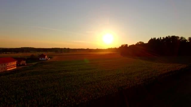 vídeos de stock e filmes b-roll de aerial: bavarian landscape in summer at sunset - crepúsculo