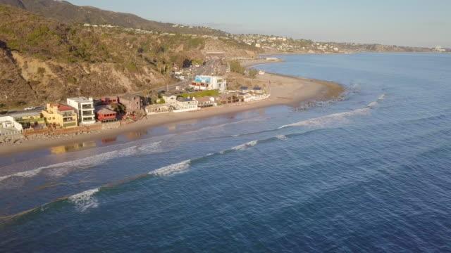 aerial: beach houses in malibu - malibu stock videos & royalty-free footage