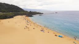 Aerial Beach Shoreline Pull Back with Rain Drops