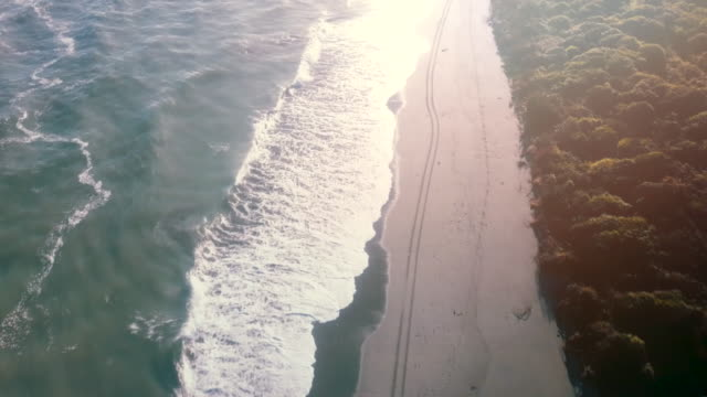 aerial beach wave on sunrise - wide stock videos & royalty-free footage