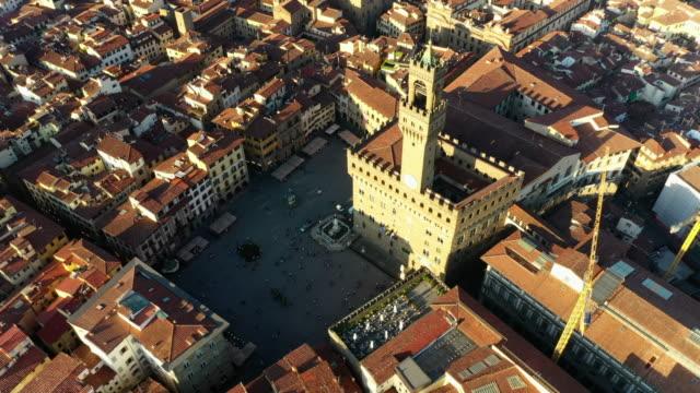 aerial: beautiful cityscape with famous palazzo vecchio - florence, italy - florens italien bildbanksvideor och videomaterial från bakom kulisserna