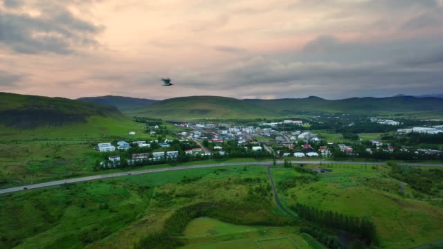 aerial beautiful landscape of view around south west mosfellsbaer city in iceland, top of view car on the road travel at south west in iceland, concept of holiday road trips is moment relaxing, road trips in iceland - iceland stock videos & royalty-free footage
