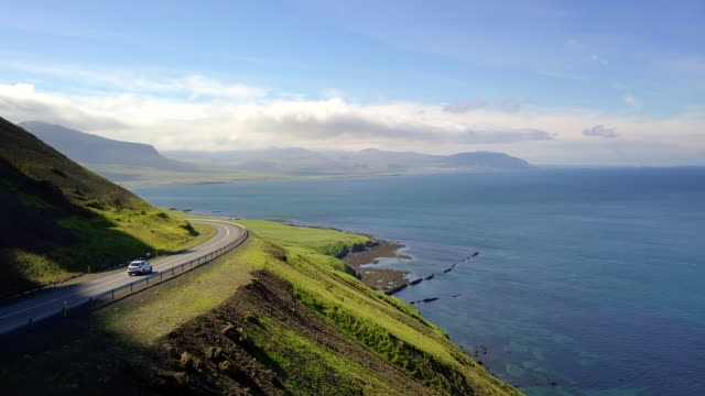 aerial beautiful landscape view of coast west land in iceland, top of view car on the road travel at west land in iceland, concept of holiday road trips is moment relaxing, road trips in iceland - iceland stock videos & royalty-free footage