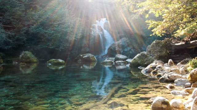 aerial / beautiful waterfall in  vintgar gorge - 川点の映像素材/bロール