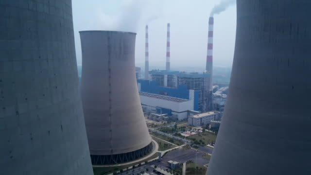 aerial between cooling towers, china - smoke stack stock videos & royalty-free footage