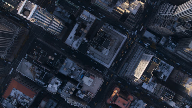 aerial bird's eye pov of midtown manhattan new york city skyscrapers and high rise office or apartment buildings. new york public library, bryant park. - 集合住宅点の映像素材/bロール