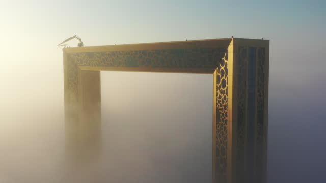 aerial birds eye view footage of dubai frame covered in fog during winter season - tower stock videos & royalty-free footage