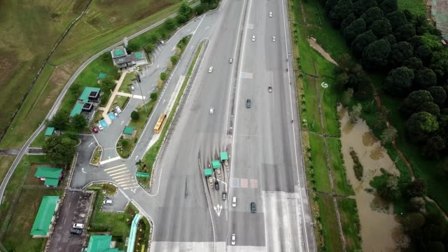 aerial birdseye tilt up from a plaza toll booth expressway in johor bahru malaysia - johor stock videos & royalty-free footage