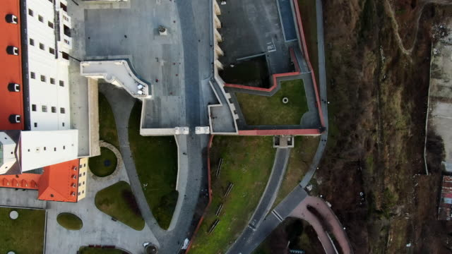 aerial bird's-eye view: bratislava castle entrance and paths in slovakia - dacherker stock-videos und b-roll-filmmaterial