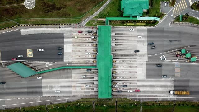 aerial birdseye view of a plaza toll booth expressway in johor bahru malaysia - johor stock videos & royalty-free footage