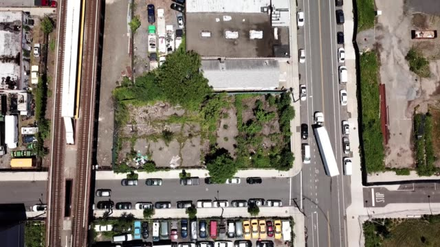 aerial birdseye view of a train line and parking lots in stapleton staten island new york - stapleton stock videos & royalty-free footage