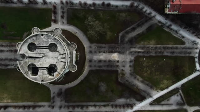aerial bird's-eye view: panning above flak tower in park in vienna, austria - 防空壕点の映像素材/bロール