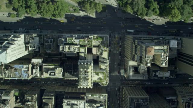 Aerial BIRDS-EYE-VIEW travelling north on 6th Avenue to pan up and reveal Central Park
