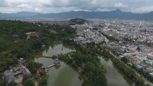 4K Aerial : Black Dragon Pool Park-Lijiang old town scene