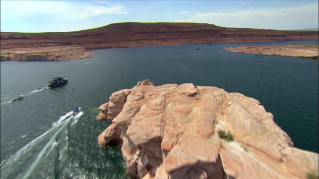 aerial boats powering on lake powell - lago powell video stock e b–roll
