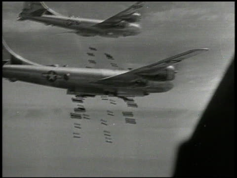 aerial bombs dropping from cargo bay bombs falling over japan landscape explosions vs b29's dropping bombs explosions over land wwii airstrike target... - stillahavskriget bildbanksvideor och videomaterial från bakom kulisserna