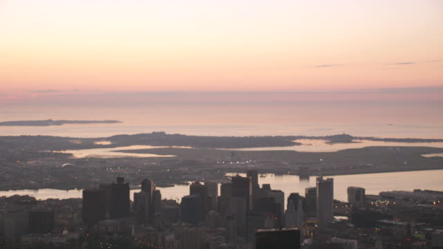 aerial boston skyline dusk, tilts down from sky - fluss charles stock-videos und b-roll-filmmaterial