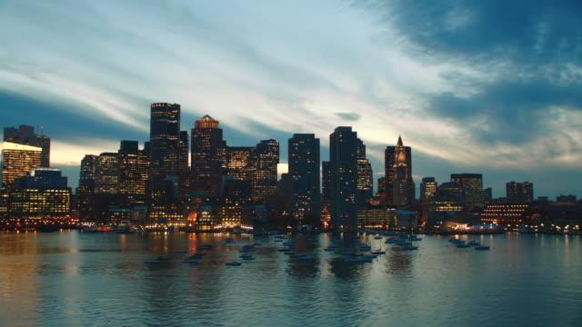 aerial boston skyline, over harbor, dusk to night - back bay boston stock videos & royalty-free footage