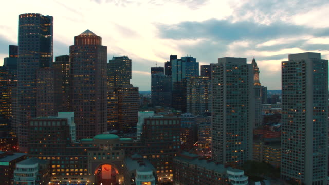 aerial boston skyline, over harbor, dusk - back bay boston stock videos & royalty-free footage