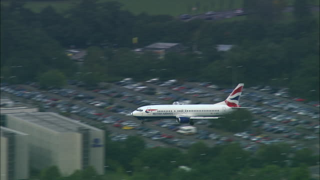 aerial british airways plane landing at gatwick airport/ west sussex, england - air to air shot stock videos and b-roll footage
